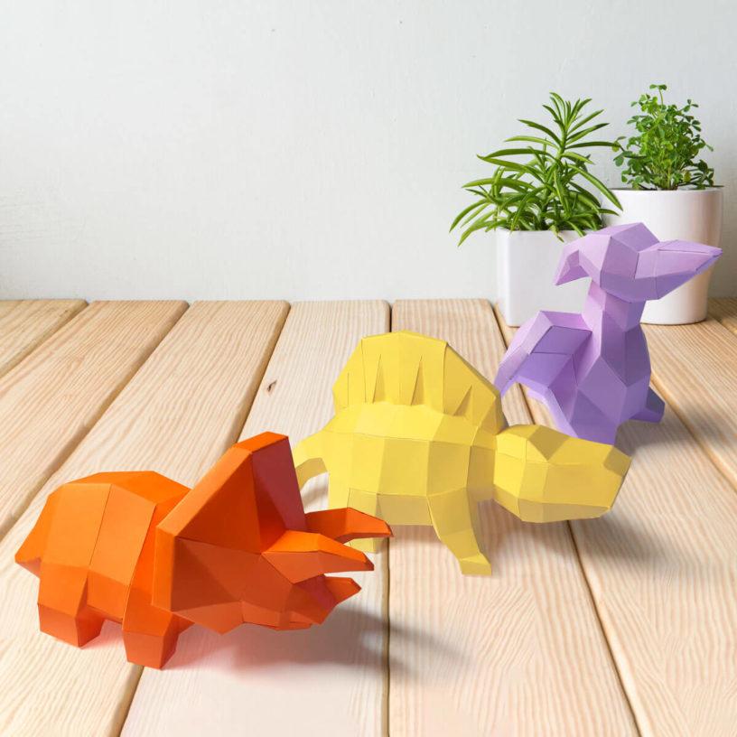 3 dinossaurinhos juntos laranja amarelo lilas